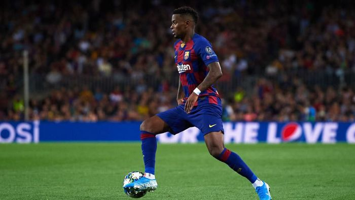 BARCELONA, SPAIN - OCTOBER 02: Nelson Semedo of FC Barcelona conducts the ball during the UEFA Champions League group F match between FC Barcelona and Inter at Camp Nou on October 02, 2019 in Barcelona, Spain. (Photo by Alex Caparros/Getty Images)