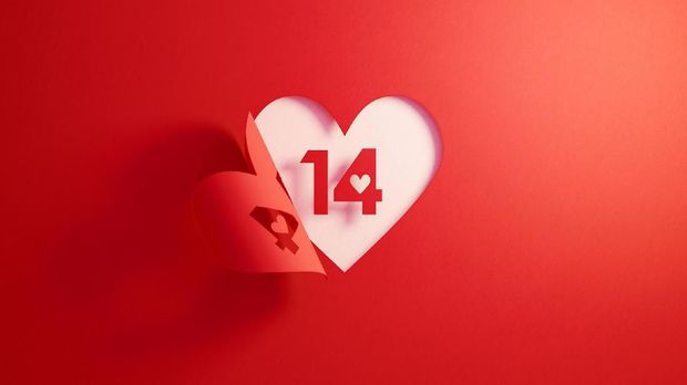 Number 14 is inside of a red folding heart shape on white background. Horizontal composition with  copy space.