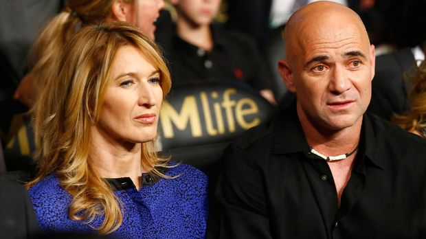 LAS VEGAS, NV - MAY 02: Andre Agassi and wife Steffi Graf watches the Leo Santa Cruz against Jose Cayetano featherweight bout on May 2, 2015 at MGM Grand Garden Arena in Las Vegas, Nevada.   Al Bello/Getty Images/AFP