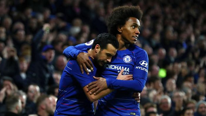 LONDON, ENGLAND - JANUARY 12:  Pedro of Chelsea celebrates with teammate Willian after scoring his teams first goal  during the Premier League match between Chelsea FC and Newcastle United at Stamford Bridge on January 12, 2019 in London, United Kingdom.  (Photo by Clive Rose/Getty Images)