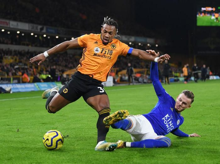 WOLVERHAMPTON, ENGLAND - FEBRUARY 14: Adama Traore of Wolverhampton Wanderers battles for possession with James Maddison of Leicester City  during the Premier League match between Wolverhampton Wanderers and Leicester City at Molineux on February 14, 2020 in Wolverhampton, United Kingdom. (Photo by Michael Regan/Getty Images)