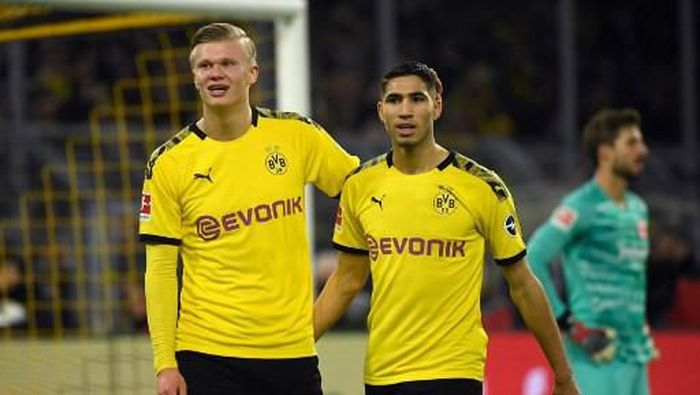 Dortmunds Norwegian forward Erling Braut Haaland and Dortmunds Moroccan defender Achraf Hakimi (R) celebrate during the German first division Bundesliga football match BVB Borussia Dortmund vs Eintracht Frankfurt, in Dortmund, western Germany on February 14, 2020. (Photo by INA FASSBENDER / AFP) / RESTRICTIONS: DFL REGULATIONS PROHIBIT ANY USE OF PHOTOGRAPHS AS IMAGE SEQUENCES AND/OR QUASI-VIDEO
