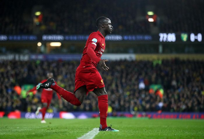 NORWICH, ENGLAND - FEBRUARY 15: Sadio Mane of Liverpool celebrates after scoring his teams first goal during the Premier League match between Norwich City and Liverpool FC at Carrow Road on February 15, 2020 in Norwich, United Kingdom. (Photo by Julian Finney/Getty Images)