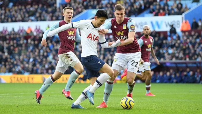 BIRMINGHAM, ENGLAND - FEBRUARY 16: Heung-Min Son of Tottenham Hotspur goes past Bjorn Engels of Aston Villa  during the Premier League match between Aston Villa and Tottenham Hotspur at Villa Park on February 16, 2020 in Birmingham, United Kingdom. (Photo by Michael Regan/Getty Images)