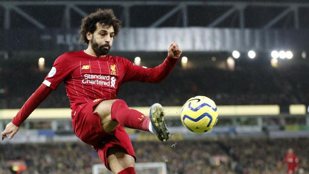 Liverpool's Mohamed Salah kicks the ball during the English Premier League soccer match between Norwich City and Liverpool at Carrow Road Stadium in Norwich, England, Saturday, Feb. 15, 2020. (AP Photo/Frank Augstein)