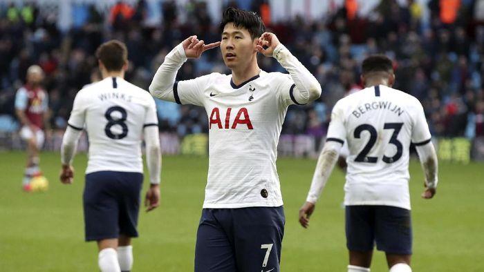 Tottenham Hotspurs Son Heung-min celebrates scoring against Aston Villa during the English Premier League soccer match at Villa Park, Birmingham, England, Sunday Feb. 16, 2020. (Nick Potts/PA via AP)
