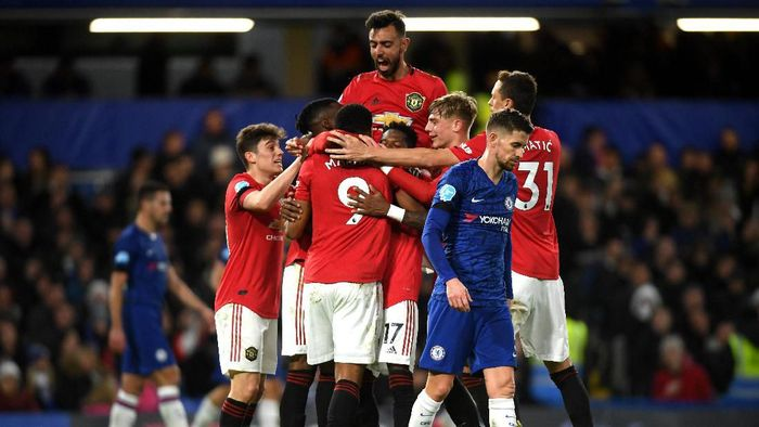 LONDON, ENGLAND - FEBRUARY 17: Anthony Martial of Manchester United celebrates after scoring his sides first goal with team mates during the Premier League match between Chelsea FC and Manchester United at Stamford Bridge on February 17, 2020 in London, United Kingdom. (Photo by Mike Hewitt/Getty Images)