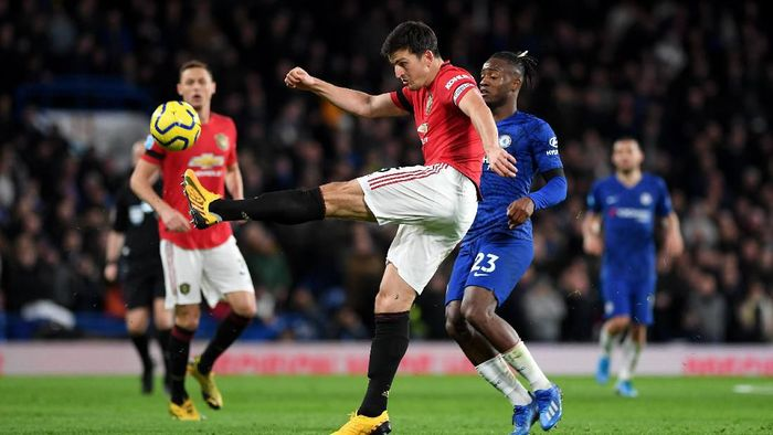 LONDON, ENGLAND - FEBRUARY 17: Harry Maguire of Manchester United clears under pressure from the Michy Batshuayi of Chelsea during the Premier League match between Chelsea FC and Manchester United at Stamford Bridge on February 17, 2020 in London, United Kingdom. (Photo by Shaun Botterill/Getty Images)