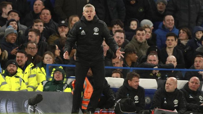 Manchester Uniteds manager Ole Gunnar Solskjaer reacts during the English Premier League soccer match between Chelsea and Manchester United at Stamford Bridge in London, England, Monday, Feb. 17, 2020. (AP Photo/Ian Walton)