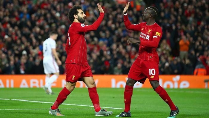 LIVERPOOL, ENGLAND - JANUARY 02: Mohamed Salah of Liverpool celebrates with Sadio Mane after scoring his teams first goal during the Premier League match between Liverpool FC and Sheffield United at Anfield on January 02, 2020 in Liverpool, United Kingdom. (Photo by Clive Brunskill/Getty Images)