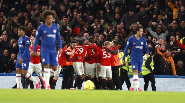 Manchester Uniteds Harry Maguire, 5, is congratulated by teammates after scoring his teams second goal during the English Premier League soccer match between Chelsea and Manchester United at Stamford Bridge in London, England, Monday, Feb. 17, 2020. (AP Photo/Ian Walton)
