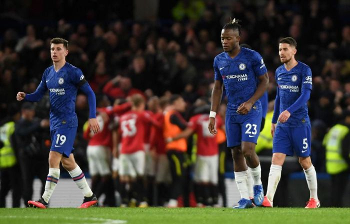 LONDON, ENGLAND - FEBRUARY 17: Michy Batshuayi of Chelsea and team mates react after Harry Maguire of Manchester United scores his sides second goal during the Premier League match between Chelsea FC and Manchester United at Stamford Bridge on February 17, 2020 in London, United Kingdom. (Photo by Mike Hewitt/Getty Images)