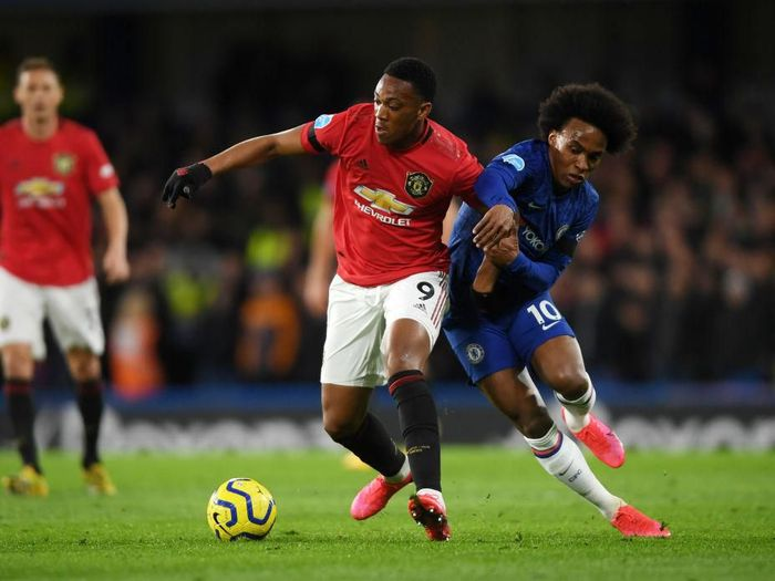 LONDON, ENGLAND - FEBRUARY 17: Anthony Martial of Manchester United battles for possession with Willian of Chelsea during the Premier League match between Chelsea FC and Manchester United at Stamford Bridge on February 17, 2020 in London, United Kingdom. (Photo by Mike Hewitt/Getty Images)