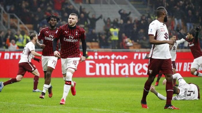 AC Milans Ante Rebic, third from left, celebrates after scoring his sides opening goal during the Serie A soccer match between AC Milan and Torino at the San Siro stadium, in Milan, Italy, Monday, Feb. 17, 2020. (AP Photo/Antonio Calanni)