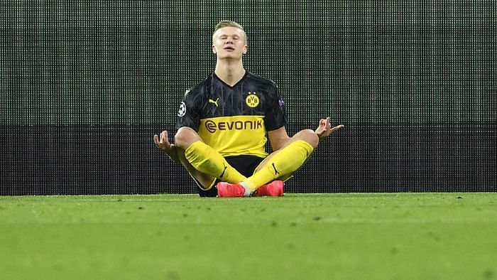Dortmunds Erling Braut Haaland poses after scoring his first goal during the Champions League round of 16 first leg soccer match between Borussia Dortmund and Paris Saint Germain in Dortmund, Germany, Tuesday, Feb. 18, 2020. (AP Photo/Martin Meissner)