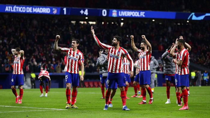 Atletico Madrid players celebrate after a 1st leg, round of 16, of the Champions League soccer match between Atletico Madrid and Liverpool at the Wanda Metropolitano stadium in Madrid, Tuesday, Feb. 18, 2020. Atletico won 1-0. (AP Photo/Manu Fernandez)
