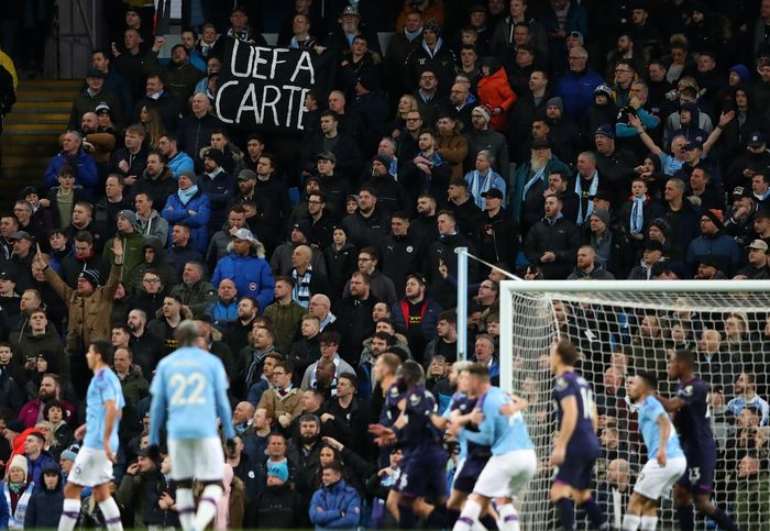 MANCHESTER, ENGLAND - FEBRUARY 19: Manchester City fans hold up a banner with a message to UEFA during the Premier League match between Manchester City and West Ham United at Etihad Stadium on February 19, 2020 in Manchester, United Kingdom. (Photo by Alex Livesey/Getty Images)