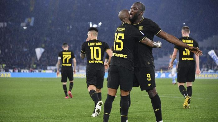 Inter Milan's Ashley Young, left, celebrates with his teammate Romelu Lukaku after scoring his sides first goal during the Serie A soccer match between Lazio and inter Milan, at Romes Olympic stadium, Sunday, Feb. 16, 2020. (Alfredo Falcone/LaPresse via AP)