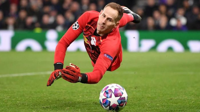 LONDON, ENGLAND - FEBRUARY 19: Peter Gulacsi of RB Leipzig makes a save during the UEFA Champions League round of 16 first leg match between Tottenham Hotspur and RB Leipzig at Tottenham Hotspur Stadium on February 19, 2020 in London, United Kingdom. (Photo by Laurence Griffiths/Getty Images)