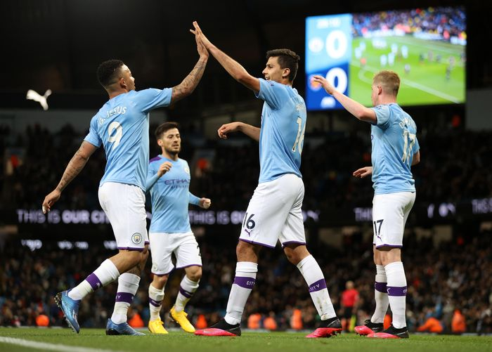 MANCHESTER, ENGLAND - FEBRUARY 19: Rodrigo of Manchester City  celebrates with Gabriel Jesus of Manchester City  after scoring his teams first goal during the Premier League match between Manchester City and West Ham United at Etihad Stadium on February 19, 2020 in Manchester, United Kingdom. (Photo by Clive Brunskill/Getty Images)