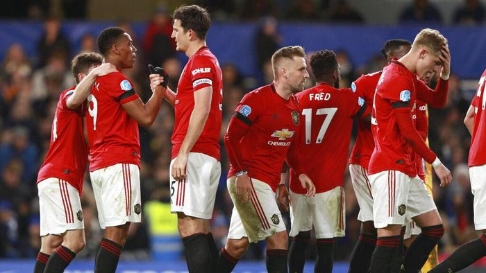 Manchester Uniteds Anthony Martial, second left, is congratulated by teammates after scoring a goal during the English Premier League soccer match between Chelsea and Manchester United at Stamford Bridge in London, England, Monday, Feb. 17, 2020. (AP Photo/Ian Walton)