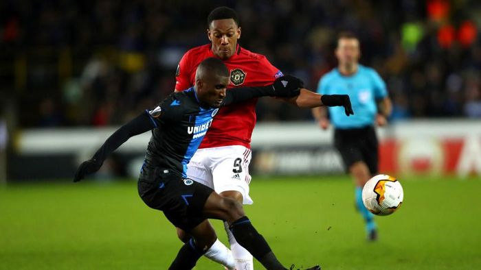 BRUGGE, BELGIUM - FEBRUARY 20: Anthony Martial of Manchester United is tackled by Clinton Mata of Club Brugge  during the UEFA Europa League round of 32 first leg match between Club Brugge and Manchester United at Jan Breydel Stadium on February 20, 2020 in Brugge, Belgium. (Photo by Dean Mouhtaropoulos/Getty Images)