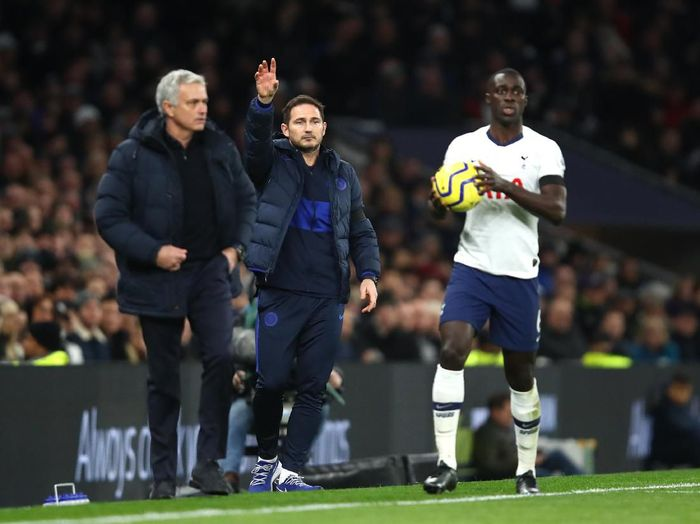 LONDON, ENGLAND - DECEMBER 22: Frank Lampard, Manager of Chelsea next to Jose Mourinho, Manager of Tottenham Hotspur and Davinson Sanchez of Tottenham Hotspur  during the Premier League match between Tottenham Hotspur and Chelsea FC at Tottenham Hotspur Stadium on December 22, 2019 in London, United Kingdom. (Photo by Julian Finney/Getty Images)