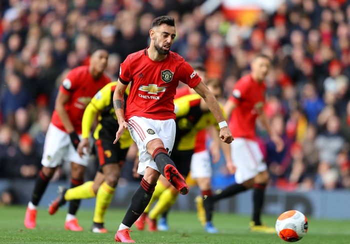 MANCHESTER, ENGLAND - FEBRUARY 23: Bruno Fernandes of Manchester United scores his teams first goal during the Premier League match between Manchester United and Watford FC at Old Trafford on February 23, 2020 in Manchester, United Kingdom. (Photo by Richard Heathcote/Getty Images)