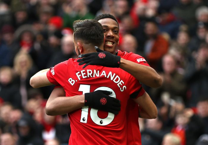 MANCHESTER, ENGLAND - FEBRUARY 23: Anthony Martial of Manchester United celebrates after scoring his teams second goal with teammate Bruno Fernandes during the Premier League match between Manchester United and Watford FC at Old Trafford on February 23, 2020 in Manchester, United Kingdom. (Photo by Clive Brunskill/Getty Images)