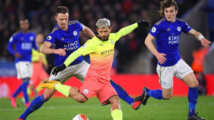 LEICESTER, ENGLAND - FEBRUARY 22: Sergio Aguero of Manchester City takes a shot with pressure from Jonny Evans of Leicester City during the Premier League match between Leicester City and Manchester City at The King Power Stadium on February 22, 2020 in Leicester, United Kingdom. (Photo by Laurence Griffiths/Getty Images)
