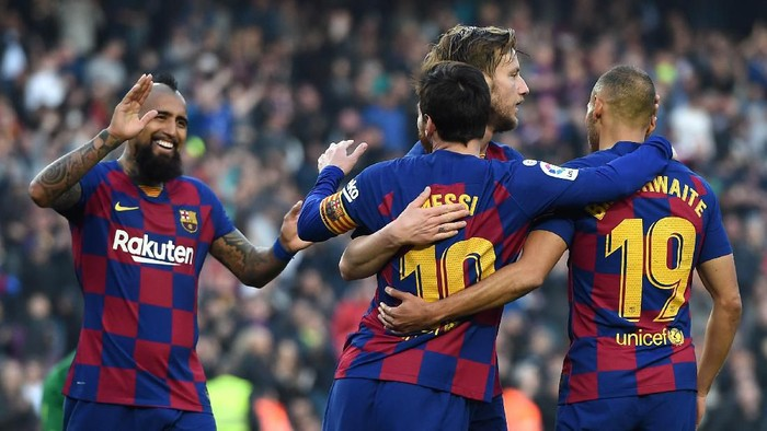 BARCELONA, SPAIN - FEBRUARY 22: Lionel Messi of FC Barcelona celebrates with teammates Martin Braithwaite, Arturo Vidal and Ivan Rakitic after scoring his teams fourth goal during the La Liga match between FC Barcelona and SD Eibar SAD at Camp Nou on February 22, 2020 in Barcelona, Spain. (Photo by Alex Caparros/Getty Images)