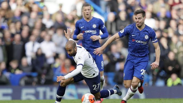 Tottenham Hotspur's Lucas Moura falls while running with the ball during their English Premier League soccer match against Chelsea in London, England, Saturday, Feb. 22, 2020. (AP Photo/Kirsty Wigglesworth)