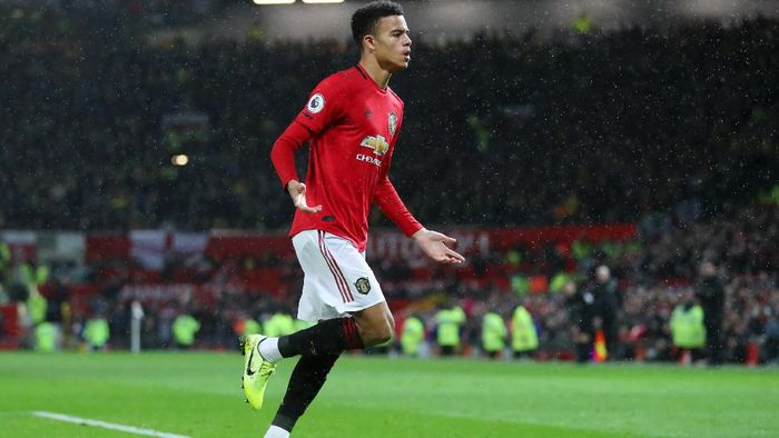 MANCHESTER, ENGLAND - JANUARY 11: Mason Greenwood of Manchester United celebrates after scoring his teams fourth goal during the Premier League match between Manchester United and Norwich City at Old Trafford on January 11, 2020 in Manchester, United Kingdom. (Photo by Catherine Ivill/Getty Images)