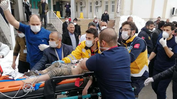 Medics and rescue workers carry a wounded boy to an ambulance after an earthquake hit villages in Baskale town in Van province, Turkey, at the border with Iran, Sunday, Feb. 23, 2020. Turkish Interior Minister Suleyman Soylu said numerous people have been killed and several others wounded in Sunday's quake. (DHA via AP)