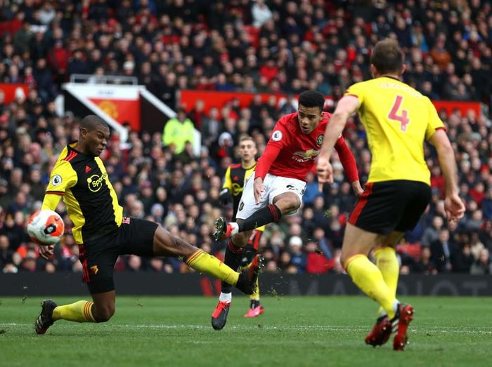 MANCHESTER, ENGLAND - FEBRUARY 23: Mason Greenwood of Manchester United scores his teams third goal during the Premier League match between Manchester United and Watford FC at Old Trafford on February 23, 2020 in Manchester, United Kingdom. (Photo by Clive Brunskill/Getty Images)