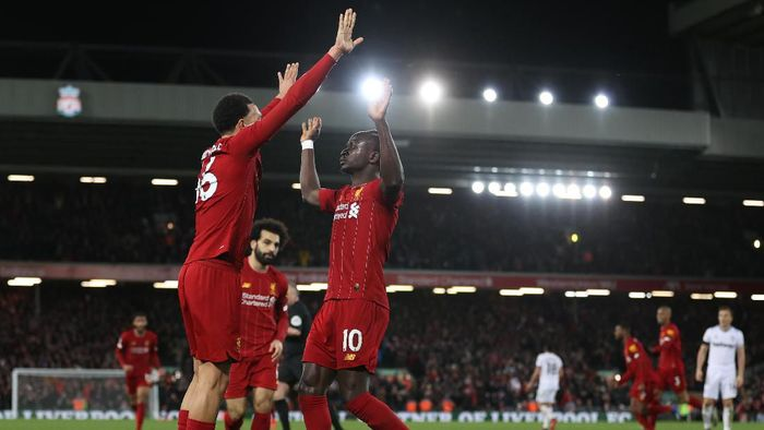 LIVERPOOL, ENGLAND - FEBRUARY 24: Sadio Mané of Liverpool celebrates after scoring his sides third goal with Trent Alexander-Arnold of Liverpool during the Premier League match between Liverpool FC and West Ham United at Anfield on February 24, 2020 in Liverpool, United Kingdom. (Photo by Clive Brunskill/Getty Images)