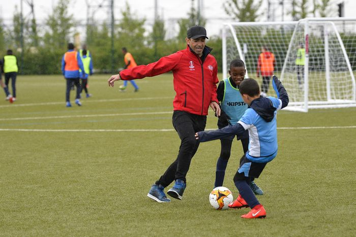 PARIS, FRANCE - MAY 10: Youri Djorkaeff plays with children during to the UEL Trophy Tour Driven by Kia on May 10, 2019 in Paris, France. (Photo by Aurelien Meunier/Getty Images for Kia)