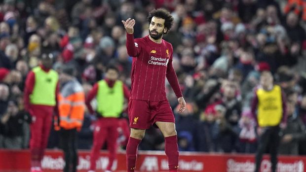 Liverpool's Mohamed Salah reacts after scoring his team's second goal during the English Premier League soccer match between Liverpool and West Ham at Anfield Stadium in Liverpool, England, Monday, Feb. 24, 2020. (AP Photo/Jon Super)