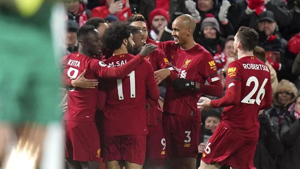 Liverpool players celebrate their first goal during the English Premier League soccer match between Liverpool and West Ham at Anfield Stadium in Liverpool, England, Monday, Feb. 24, 2020. (AP Photo/Jon Super)