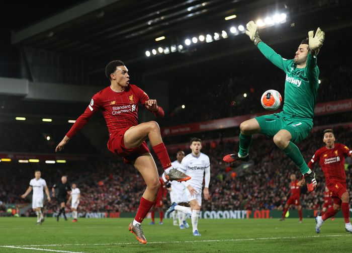 LIVERPOOL, ENGLAND - FEBRUARY 24: Trent Alexander-Arnold of Liverpool passes the ball past Łukasz Fabiański of West Ham United for Sadio Mané of Liverpool to scores his sides third goal during the Premier League match between Liverpool FC and West Ham United at Anfield on February 24, 2020 in Liverpool, United Kingdom. (Photo by Clive Brunskill/Getty Images)