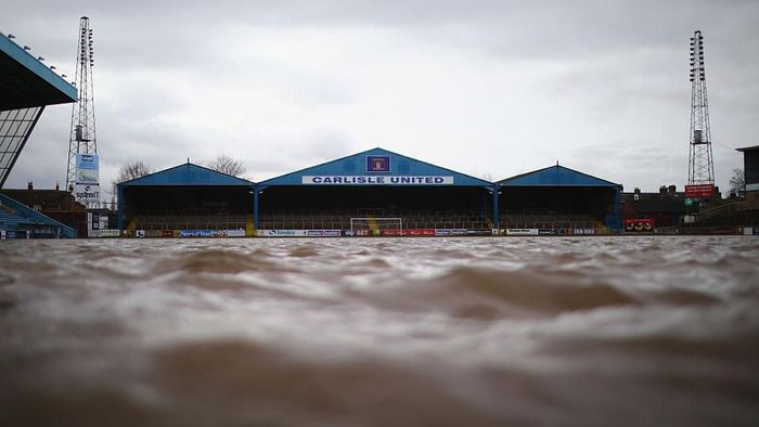 CARLISLE, UNITED KINGDOM - DECEMBER 09:  The pitch at Carlisle Football Club is still partly submerged after flooding created by Storm Desmond on December 9, 2015 in Carlisle, United Kingdom. Contractors and utilities workers are now working towards getting people back in their homes as forecasters predict another 12 hours of rain, although the effects will not be as severe as last weekend.  (Photo by Christopher Furlong/Getty Images)