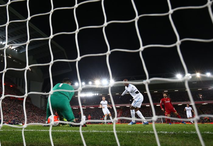 LIVERPOOL, ENGLAND - FEBRUARY 24: Mohamed Salah of Liverpool scores his sides second goal during the Premier League match between Liverpool FC and West Ham United at Anfield on February 24, 2020 in Liverpool, United Kingdom. (Photo by Clive Brunskill/Getty Images)
