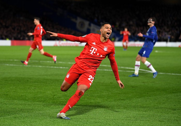 LONDON, ENGLAND - FEBRUARY 25: Serge Gnabry of Bayern Munich celebrates after scoring his teams second goal  during the UEFA Champions League round of 16 first leg match between Chelsea FC and FC Bayern Muenchen at Stamford Bridge on February 25, 2020 in London, United Kingdom. (Photo by Mike Hewitt/Getty Images)