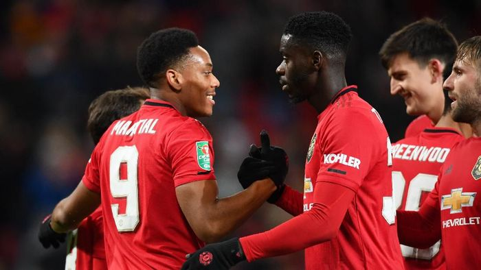 MANCHESTER, ENGLAND - DECEMBER 18: Anthony Martial of Manchester United celebrates with teammates Juan Mata, Eric Bailly, Luke Shaw and Harry Maguire of Manchester United after scoring their teams third goal during the Carabao Cup Quarter Final match between Manchester United and Colchester United at Old Trafford on December 18, 2019 in Manchester, England. (Photo by Clive Mason/Getty Images)