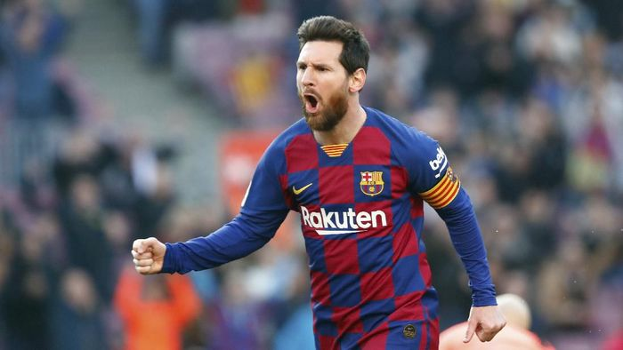 Barcelonas Lionel Messi celebrates after scoring his sides opening goal during a Spanish La Liga soccer match between Barcelona and Eibar at the Camp Nou stadium in Barcelona, Spain, Saturday Feb. 22, 2020. (AP Photo/Joan Monfort)