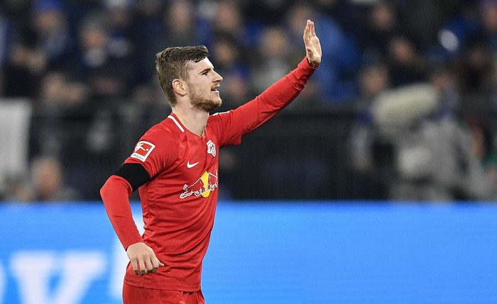 Leipzigs Timo Werner celebrates after scoring his sides second goal during the German Bundesliga soccer match between FC Schalke 04 and RB Leipzig at the arena in Gelsenkirchen, Germany, Saturday, Feb. 22, 2020. (AP Photo/Martin Meissner)