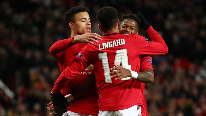 MANCHESTER, ENGLAND - FEBRUARY 27: Fred of Manchester United celebrates with teammates Mason Greenwood and Jesse Lingard of Manchester United after scoring his teams fourth goal during the UEFA Europa League round of 32 second leg match between Manchester United and Club Brugge at Old Trafford on February 27, 2020 in Manchester, United Kingdom. (Photo by Clive Brunskill/Getty Images)