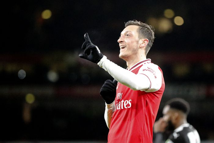 Arsenals Mesut Ozil celebrates after scoring his sides third goal during the English Premier League soccer match between Arsenal and Newcastle at the Emirates Stadium in London, Sunday, Feb. 16, 2020.(AP Photo/Frank Augstein)