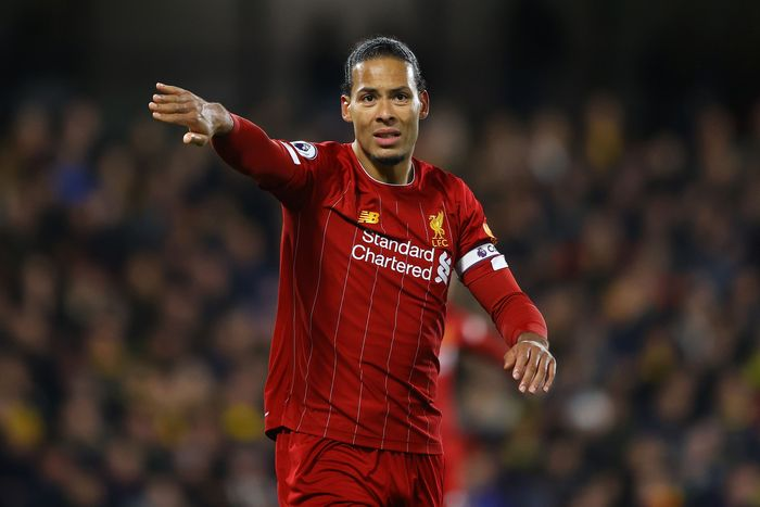 WATFORD, ENGLAND - FEBRUARY 29: Virgil van Dijk of Liverpool signals to a team mate during the Premier League match between Watford FC and Liverpool FC at Vicarage Road on February 29, 2020 in Watford, United Kingdom. (Photo by Richard Heathcote/Getty Images)