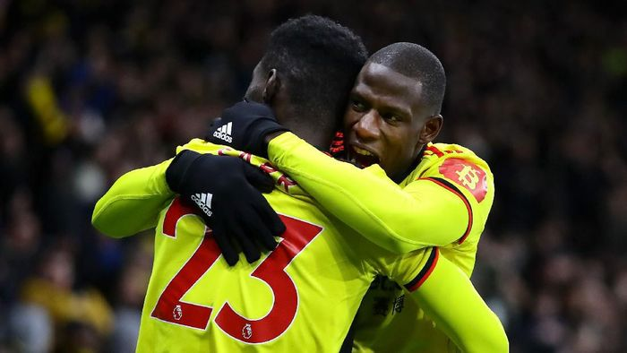 WATFORD, ENGLAND - FEBRUARY 29: Ismaila Sarr of Watford celebrates after scoring his teams first goal with teammate Abdoulaye Doucoure during the Premier League match between Watford FC and Liverpool FC at Vicarage Road on February 29, 2020 in Watford, United Kingdom. (Photo by Richard Heathcote/Getty Images)